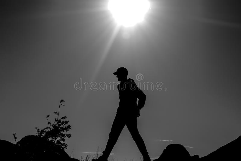 Silhouette in natural backlight stock photo