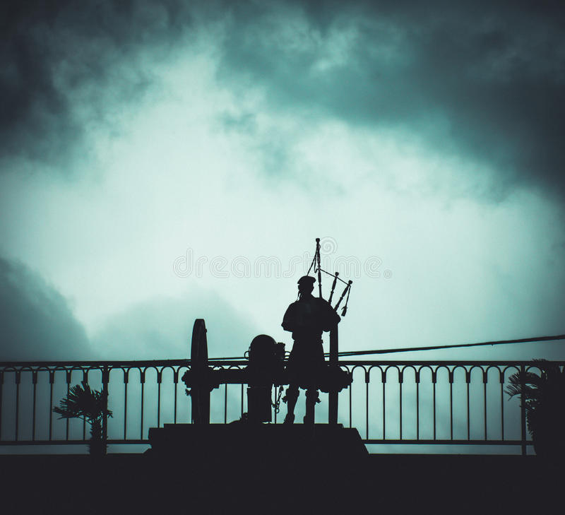 Silhouette of New Orleans Bagpipe Player and Canon royalty free stock photos