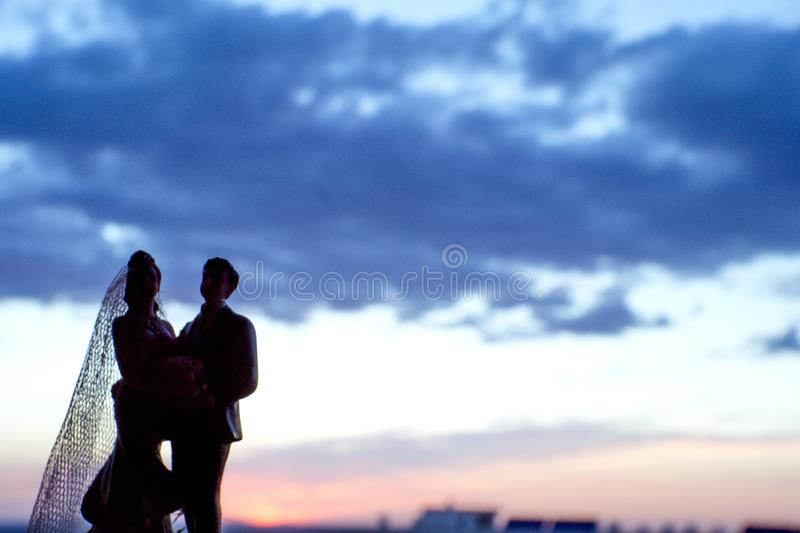 Silhouette of newlyweds with sunrise background stock photo