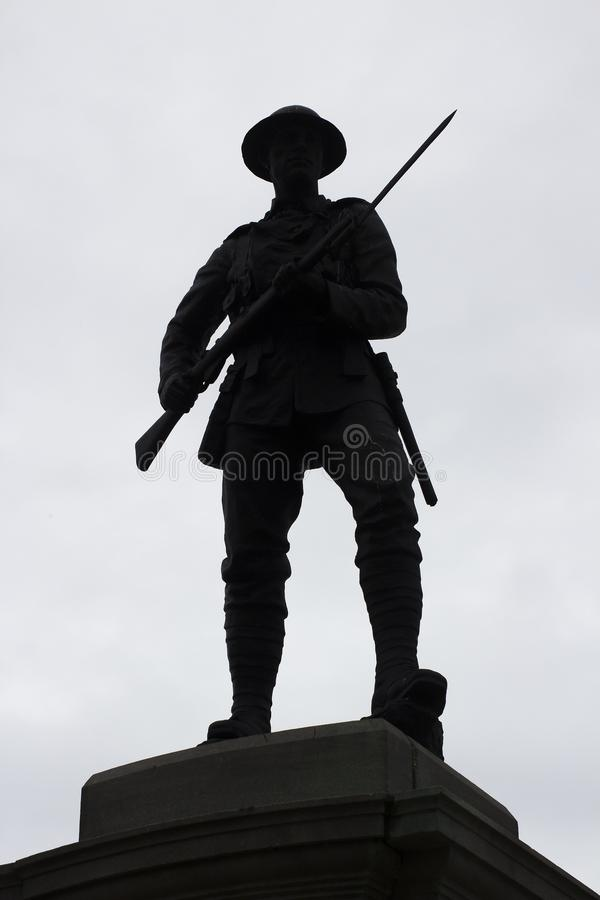 Free Silhouette Of A Bronze British Tommy Statue With Drawn Bayonet On A UK War Memorial Royalty Free Stock Photos - 100384118