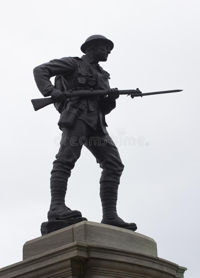 Free Silhouette Of A Bronze British Tommy Statue With Drawn Bayonet On A UK War Memorial Stock Photography - 100384152