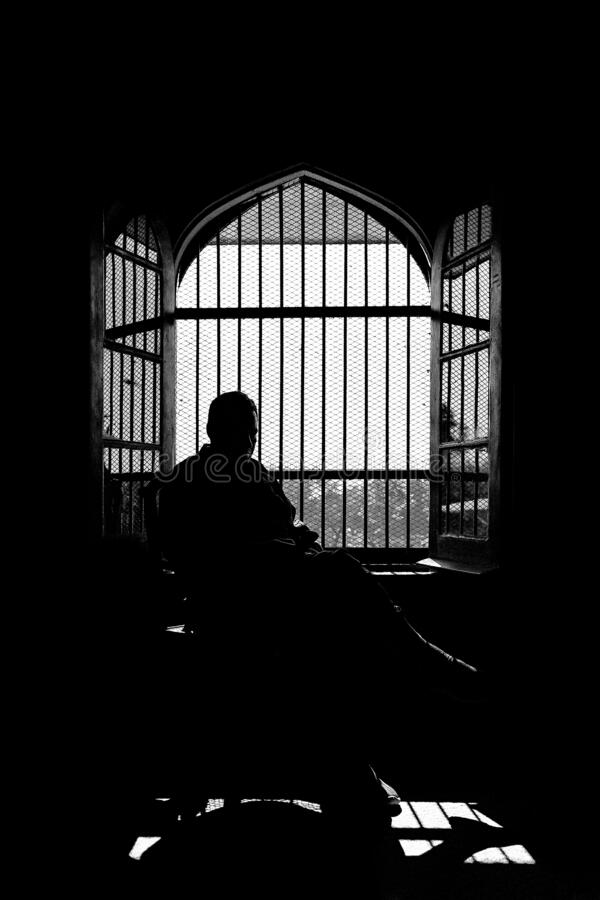 Free Silhouette Of A Man Sitting In The Dark Against The Window Stock Photo - 182224710