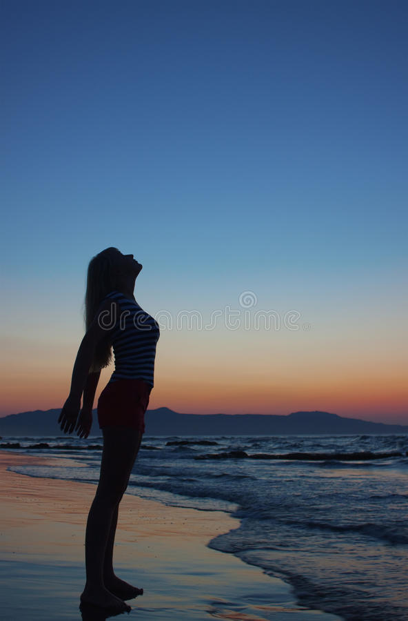 Free Silhouette Of A Woman On A Beach Stock Photo - 10061640
