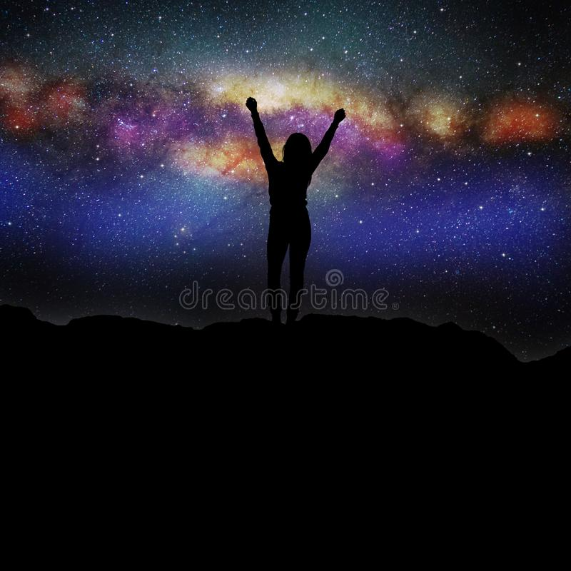 Free Silhouette Of A Woman Standing Under On The Background Of The Beautiful Universe. Stock Photo - 163977420