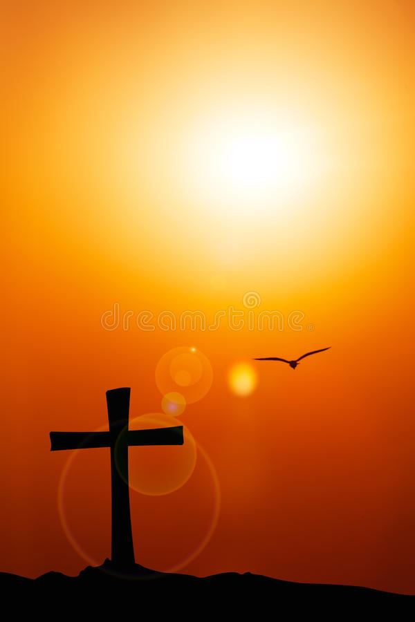 Free Silhouette Of The Cross And Bird With The Sunset Flare. Stock Photo - 67907030