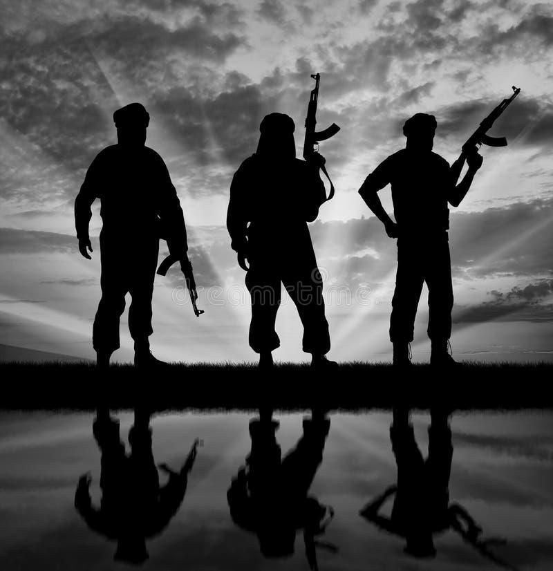 Free Silhouette Of Three Terrorists Stock Photography - 64005452