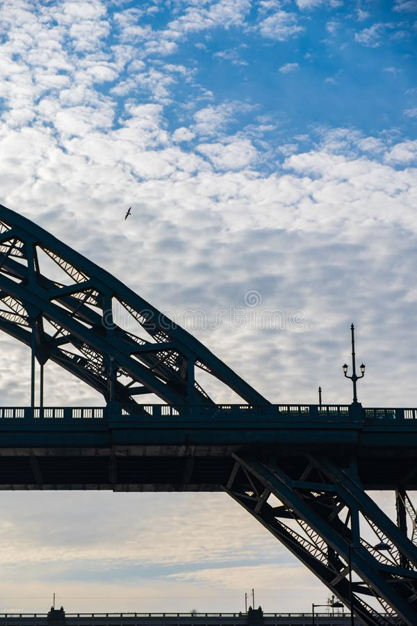 Free Silhouette Of Tyne Bridge And A Sea Gull Flying In The Distance Against A Beautiful Sky In Newcastle, UK Stock Photos - 144466263