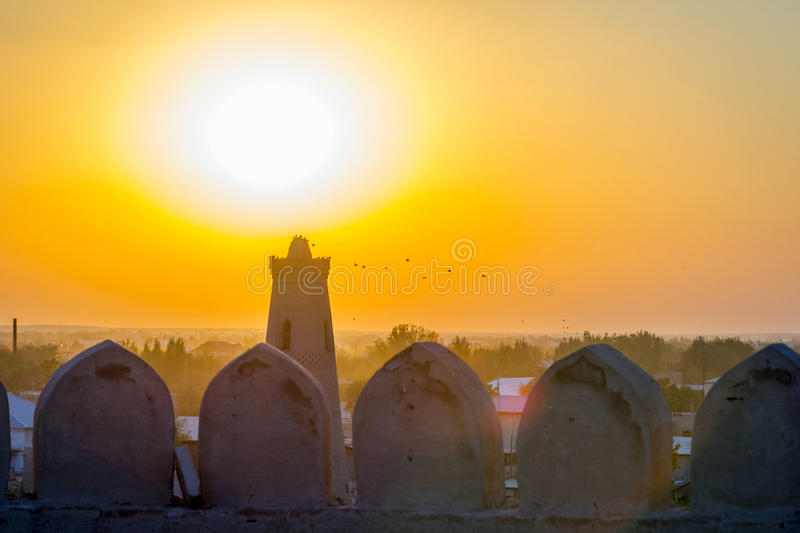 Silhouette of old city wall in sunset, Khiva. Silhouette of old city wall and minaret in sunset, Khiva, Uzbekistan stock photos