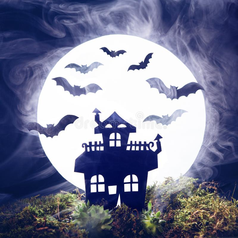Halloween. Silhouette of an old house and bats on a background of the full moon. Fog, moss royalty free stock images