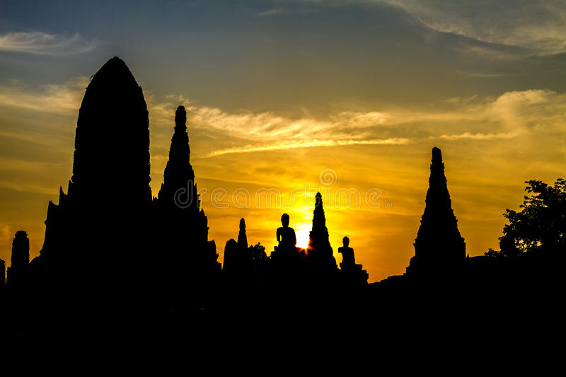 Silhouette old stature. With sunset at Wat Chaiwattanaram temple , Ayutthaya, Thailand stock photography