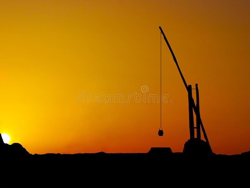 Silhouette old water well royalty free stock photo