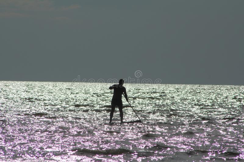 Man on Stand Up Paddle board. stock photos