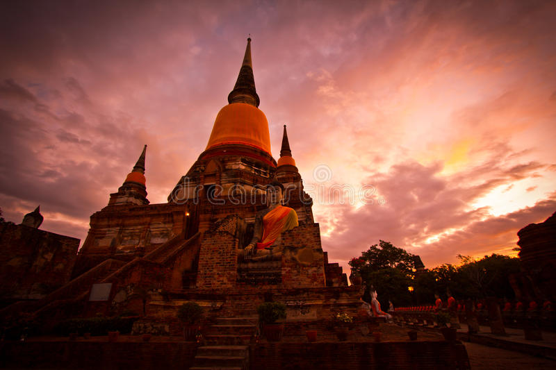 Silhouette of pagoda at the temple. Pagoda in the sunset at Wat Yai Chai Mongkhon in Ayutthaya province of Thailand royalty free stock images