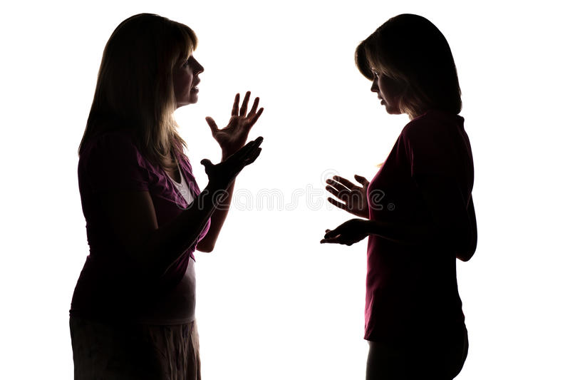 Silhouette of parenting daughter of a teenager. On white isolated background, parent screaming, teenager listens with misunderstanding royalty free stock images