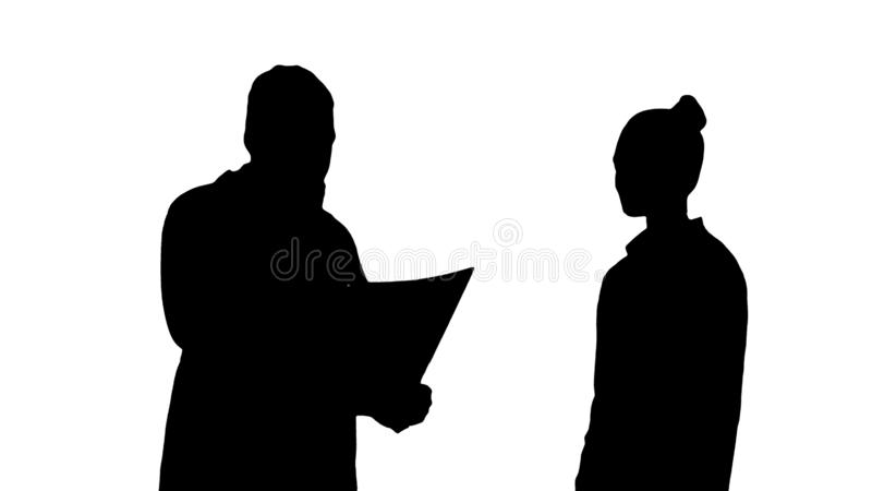 Silhouette Patient comes to doctor with x ray. Physiotherapist explaining x-ray to patient. royalty free illustration