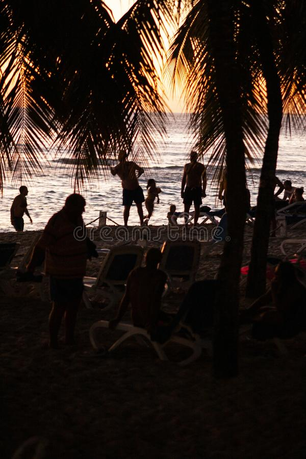Silhouette of people on the beach at sunset. BAYAHIBE, DOMINICAN REPUBLIC 13 DECEMBER 2019: Silhouette of people on the beach at sunset royalty free stock images