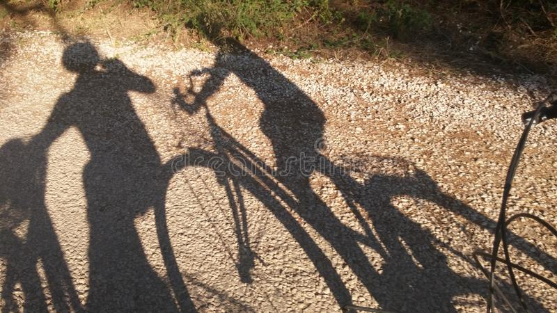 Silhouette of people and bicycle. Cirali Turkey velocity summer time stock photos