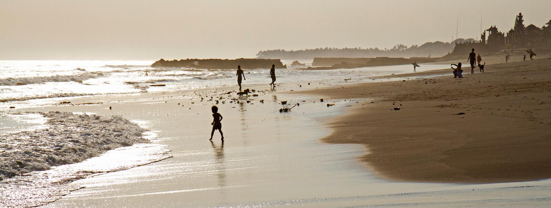 People enjoying sunset on Canggu beach in Bali, Indonesia royalty free stock photo