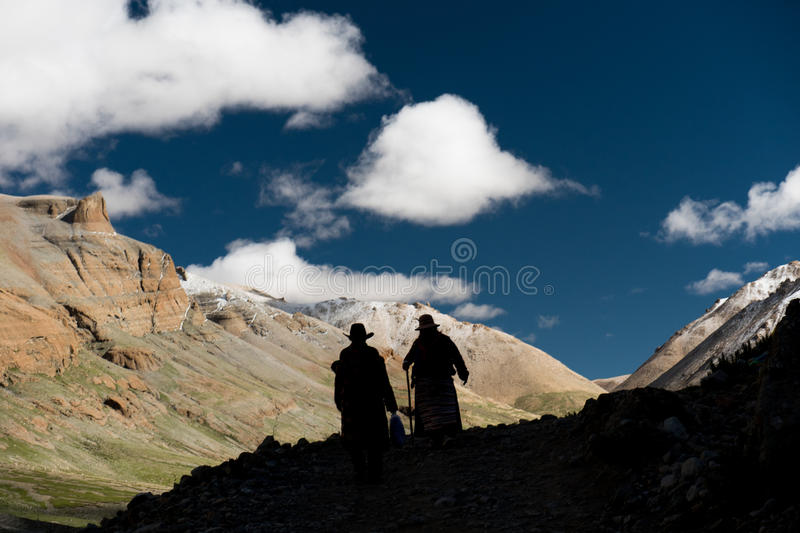 Silhouette of people Himalayas mountain Tibet sky and clouds. Kailash Yantra.lv 2016 TIBET Himalayas mountain royalty free stock photography