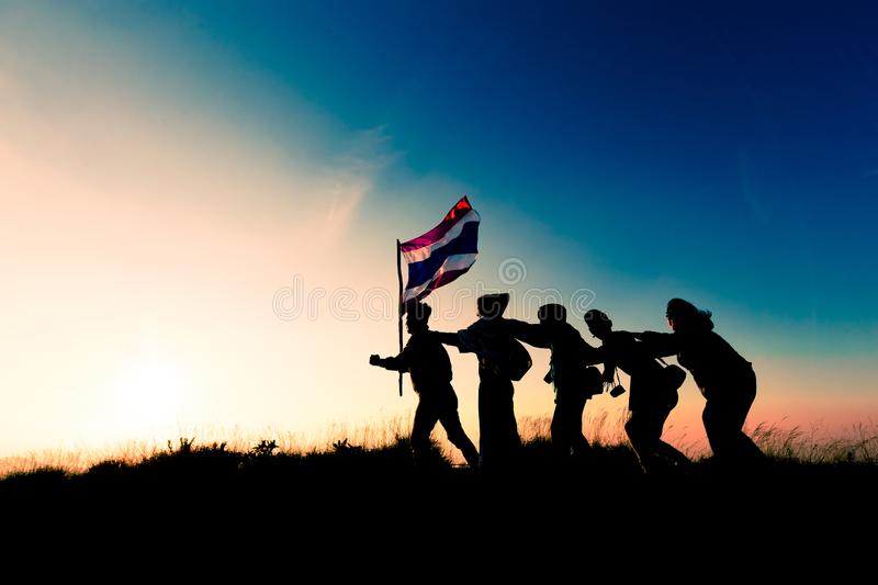 Silhouette of people holding Thailand flag and Move forward royalty free stock image