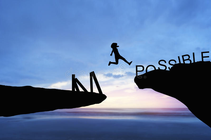 silhouette people jumping over the rock frome word impossible on sea in the morning royalty free stock photo