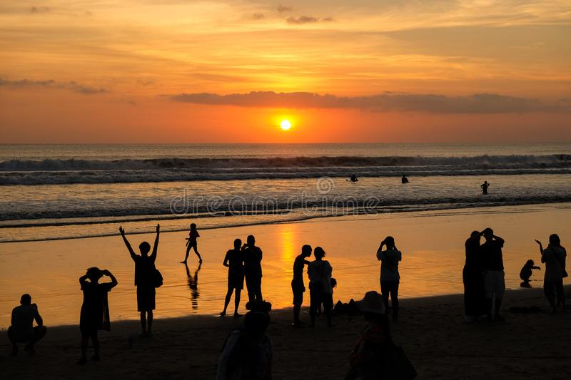 Silhouette of People looking at Sunset at Kuta stock photos