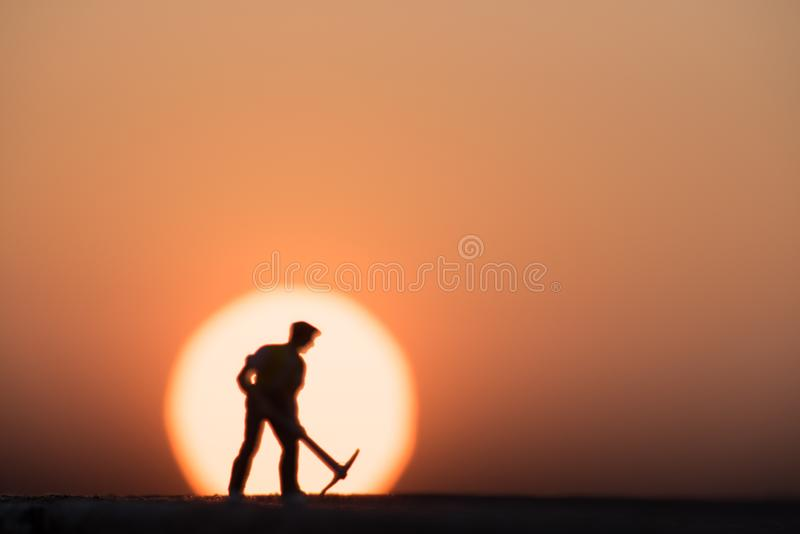 Silhouette people mining on sky sunset background. stock photo