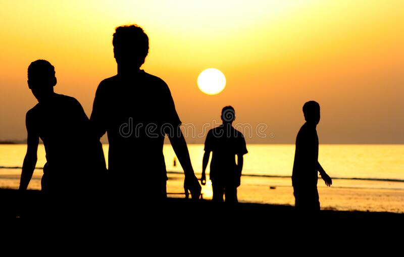 Silhouette of 4 People Near Ocean during Sunset royalty free stock image