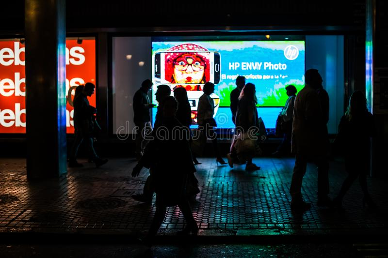 Silhouette of people shopping in the center of the city. People in the sales. stock image