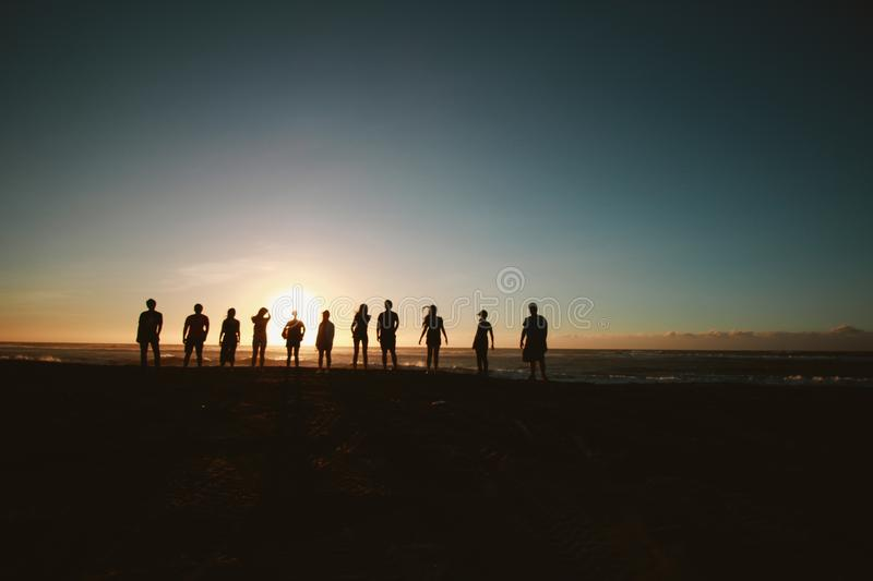 Silhouette of People during Sunset royalty free stock image