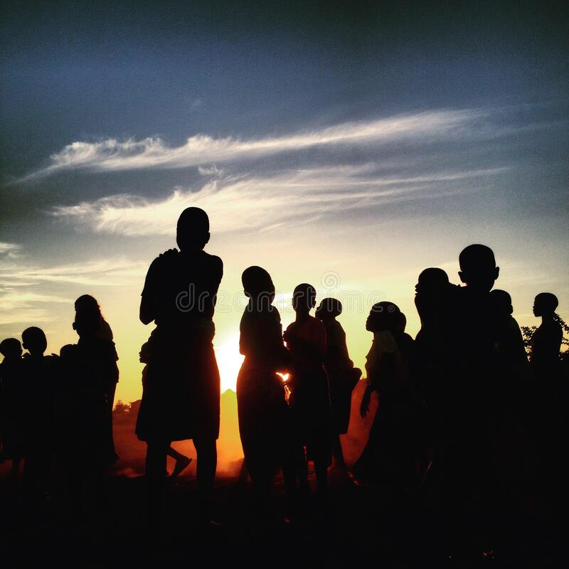 Silhouette of people at sunset stock images