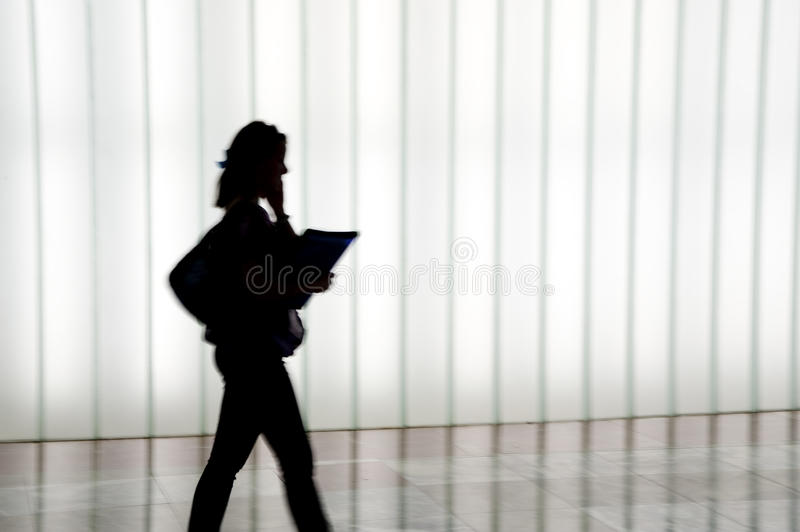 Silhouette of people walking stock images