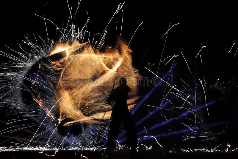 Silhouette of the person against the background of fire royalty free stock photography