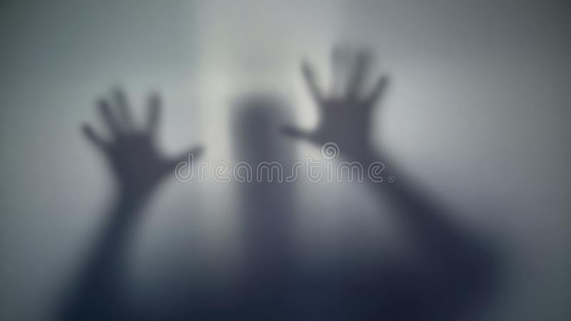 Silhouette of person asking of help, scary supernatural alien, strange creature. Stock photo royalty free stock photos