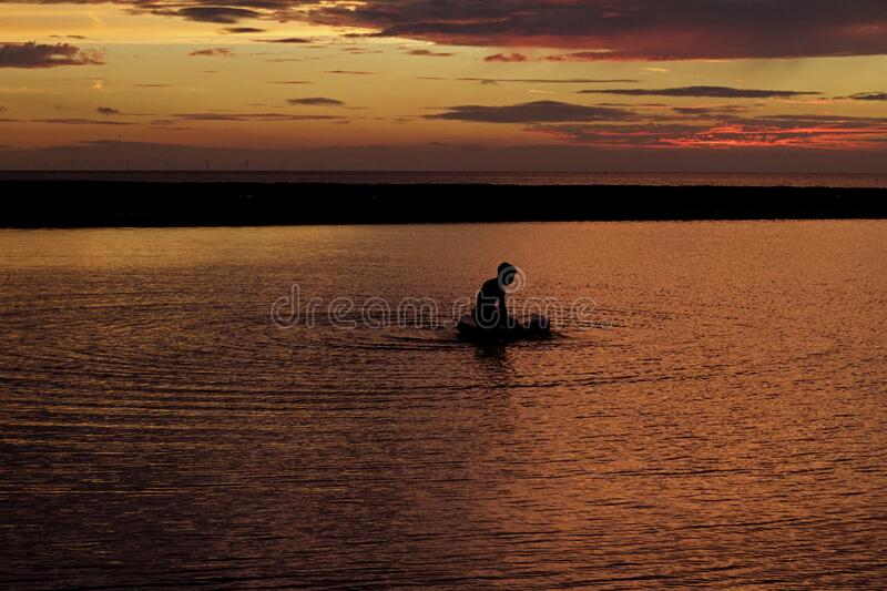 Silhouette Of Person On Body Of Water During Sunset Free Public Domain Cc0 Image