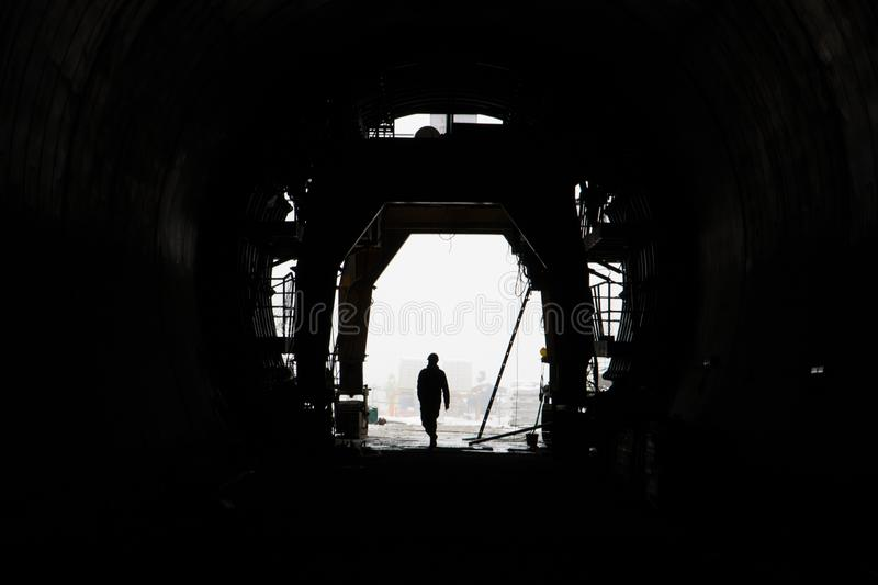 The silhouette of a person in a high-speed railway tunnel under construction stock image