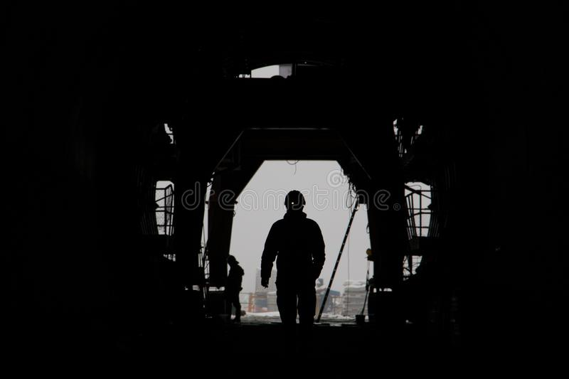 The silhouette of a person in a high-speed railway tunnel under construction royalty free stock photo
