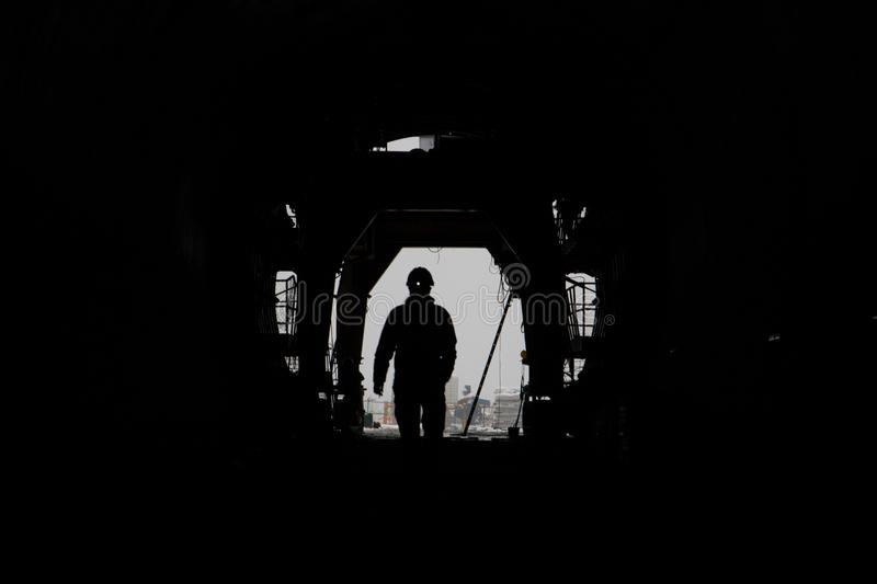The silhouette of a person in a high-speed railway tunnel under construction royalty free stock images