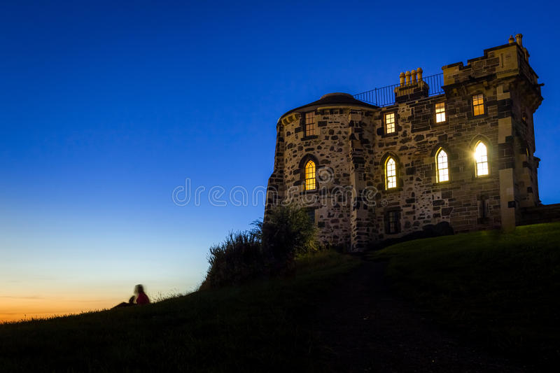 Silhouette of a person sitting near Gothic House royalty free stock photography