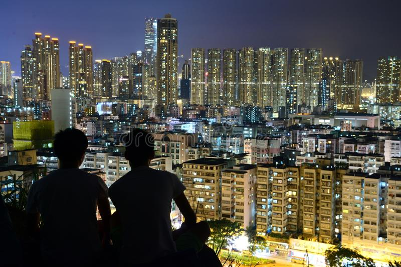 Silhouette of 2 Person on Top of the Building during Nighttime royalty free stock image