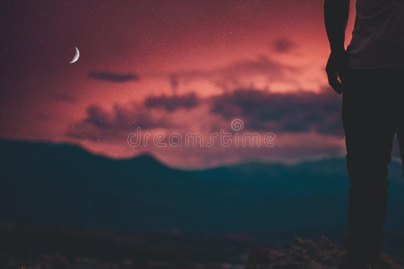 Silhouette Of A Person Watching A Crimson Sky royalty free stock photo