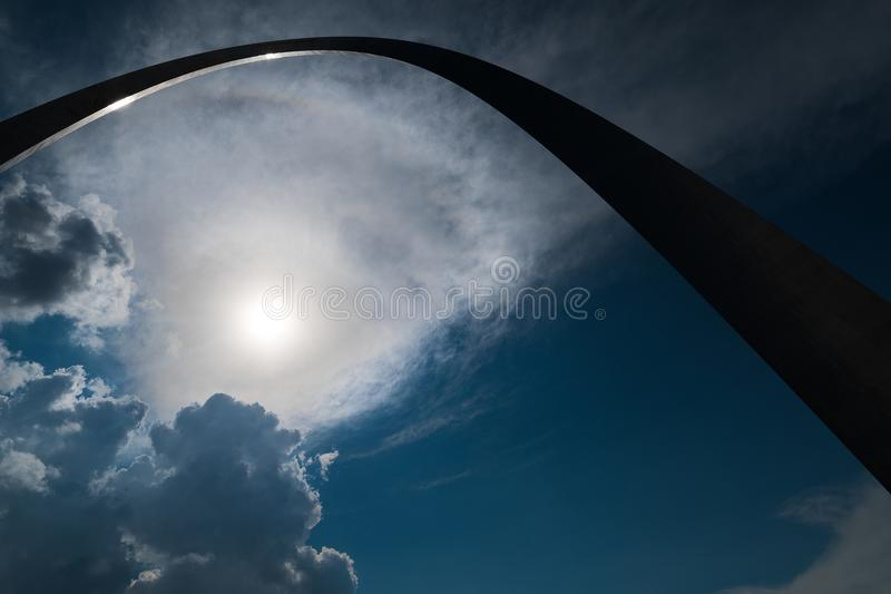 A Silhouette perspective of the gate way arch in st louis misouri. A view of the Gateway arch in ST. Louis Misouri. The arch was designed to represent the royalty free stock photos