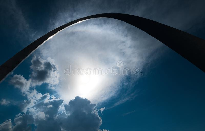 A Silhouette perspective of the gate way arch in st louis misouri. A view of the Gateway arch in ST. Louis Misouri. The arch was designed to represent the stock photo