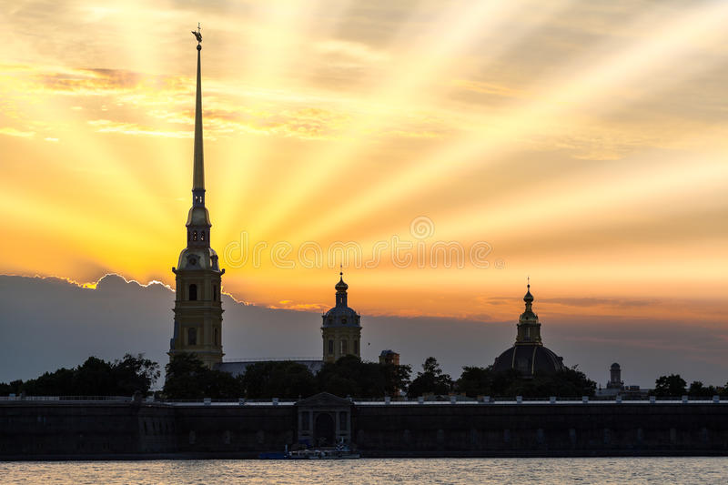 Silhouette of the Peter and Paul Fortress with sun lights. Saint-Petersburg, Russia. Silhouette of the Peter and Paul Fortress with sunset and sun lights. Saint stock images