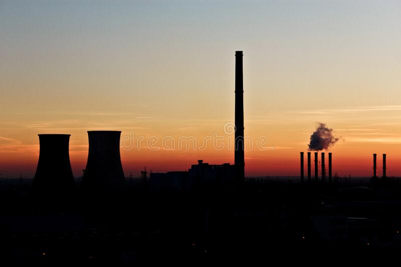 Silhouette Photo of Factory during Dusk stock photography