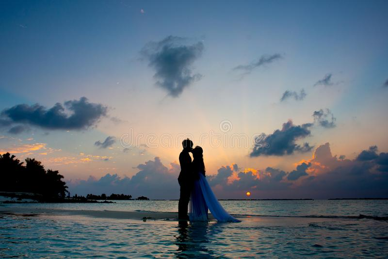 Silhouette Photo of Man and Woman Kisses Between Body of Water stock photography