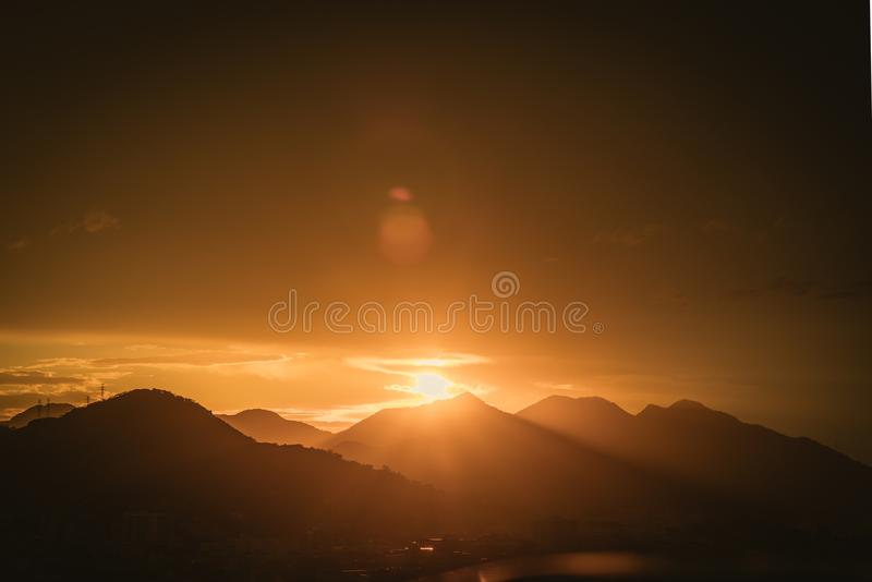 Silhouette Photo of Mountain Range during Golden Hour stock photography