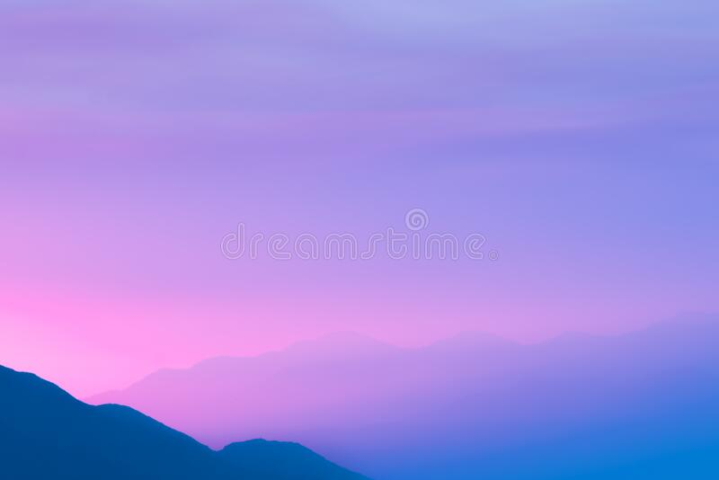 Silhouette Photo of a Mountain during Sunset stock images