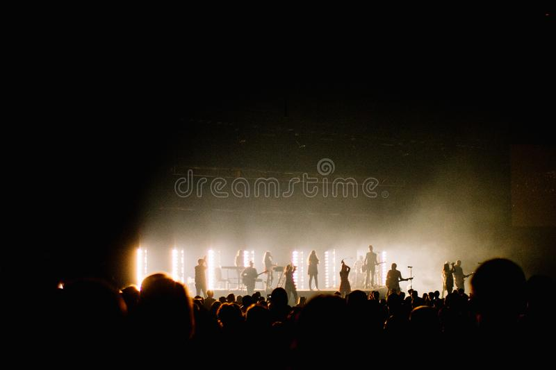 Silhouette Photo of Music Band Playing on Stage royalty free stock image