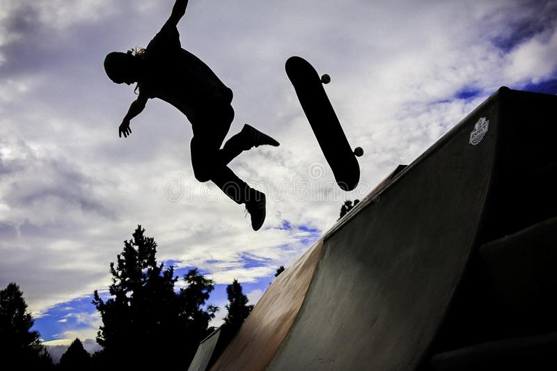 Silhouette Photo Of Person Doing Skateboard royalty free stock photo